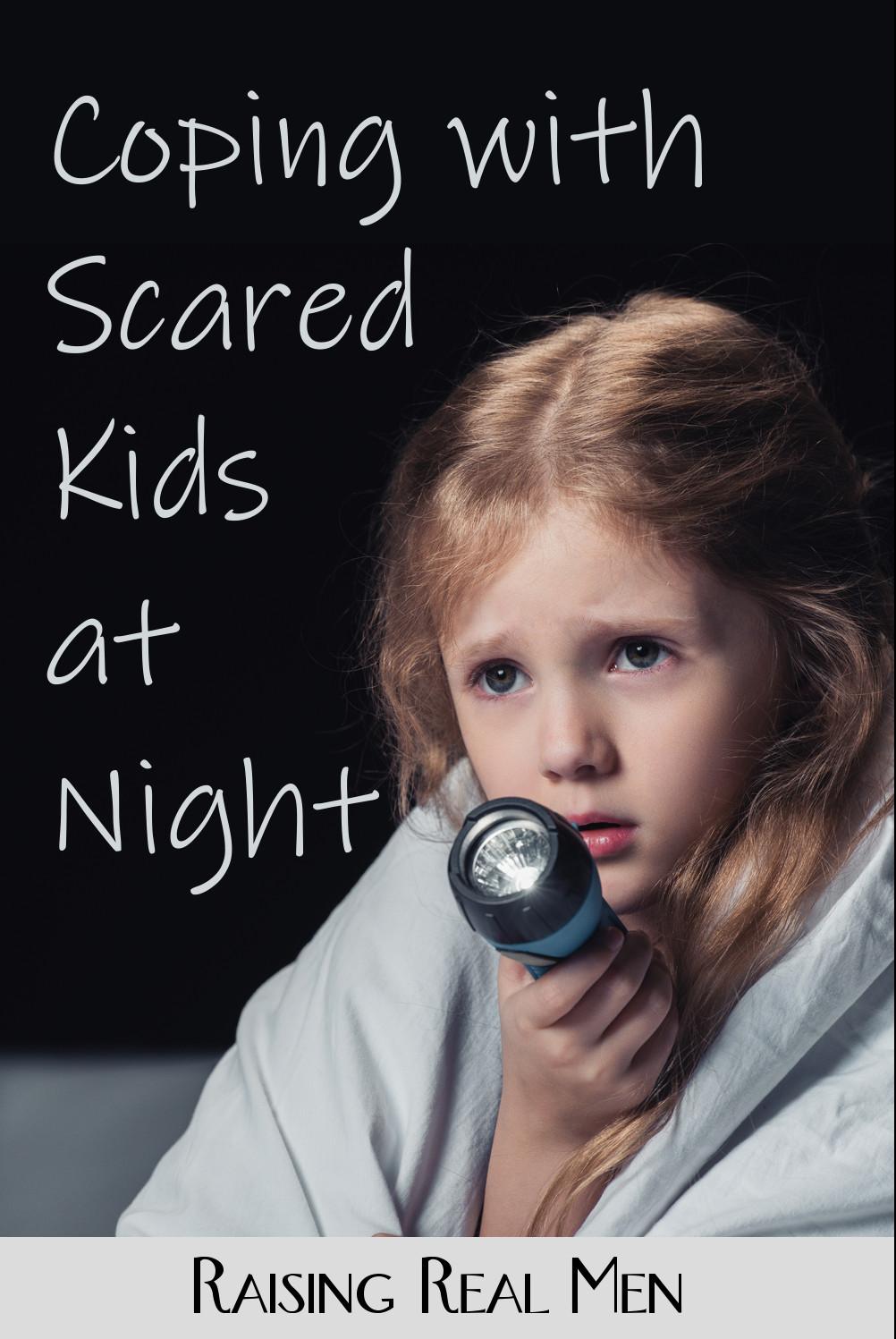 Frightened child with flashlight