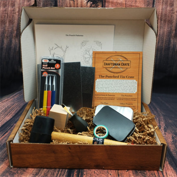 Punched Tin Crate open, showing mallet, nail punches, wood backing of two kinds, two wallet tins, three pieces of tin, tape, and instructions