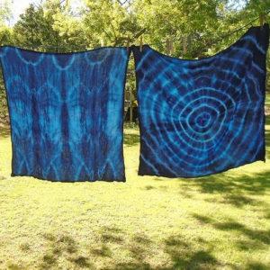 Photo of two fabrics dyed in shibori indigo style